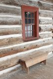 Log house window and bench Royalty Free Stock Image