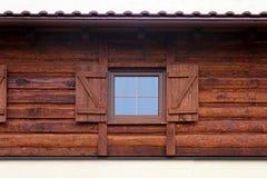 Log house window Stock Images