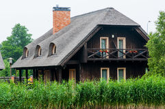 Log houses with a reed roof Royalty Free Stock Photos