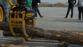 Log loader or forestry machine moves fresh cut logs for loading Stock Images