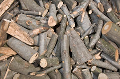 Log pile. Background of piled firewood logs Stock Photos