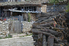 Log pile in Greek Town Royalty Free Stock Photo