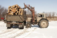 Log removal for truck with tractor Royalty Free Stock Image