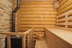 Log sauna with heater Royalty Free Stock Photography