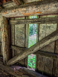 Log shelter with window Royalty Free Stock Image