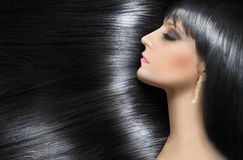 Log shiny hair of a beautiful brunette stock images