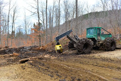 Log skidder and muddy skid trail royalty free stock photos
