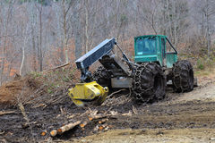 Log skidder parked on muddy skid trail royalty free stock image