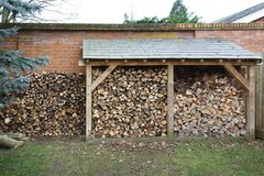 Log store with firewood royalty free stock images