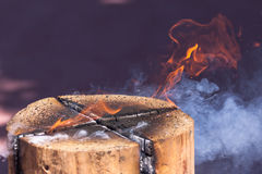 Log stove. Burning wood - Scandinavian timber stove royalty free stock photo