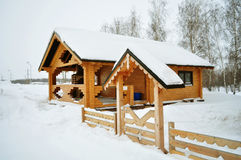 Log in suburban home, real estate. Snow on the house, winter cabin, ski chalet or finnish sauna, residential structure, building exterior, non-urban scene Stock Image