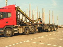 Log Transporter. A heavy haulage lorry trailer designed for hauling logs and raw timber Stock Images