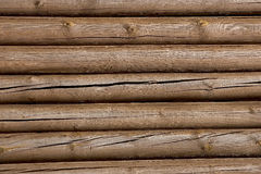 Log wall background. In a sunny day Stock Photography