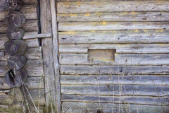The log wall of an old northern house. And a window Royalty Free Stock Image