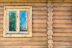 Log wall with a window Royalty Free Stock Photos