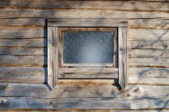 Log wall and window Royalty Free Stock Image