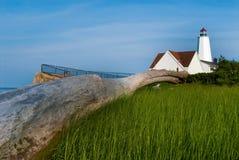 Log Washed Up Near Lighthouse Stock Images