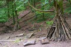 Log wigwam in the middle of the woods Royalty Free Stock Photos