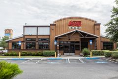 Logans Roadhouse Restaurant Storefront. Logan`s Roadhouse storefront of restaurant specializing in steaks, ribs, and spirits royalty free stock photos