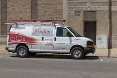 Frontier Communications Vehicle In Front of a Central Office. Frontier is a rural telecommunications provider