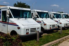 Logansport - Circa June 2018: USPS Post Office Mail Trucks. The Post Office is Responsible for Providing Mail Delivery V Stock Images