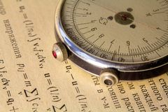 Logarithmic ruler close up on a background of the scientific literature royalty free stock photo