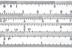 Logarithmic scale of the slide rule extremal close up Royalty Free Stock Photo