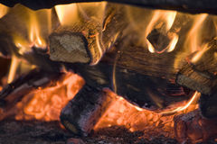 Logfire in baker's oven royalty free stock image