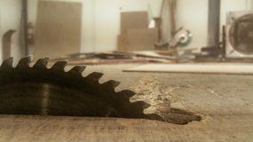 Logger dissect wood steel iron saw blade sawing the wood stock photos