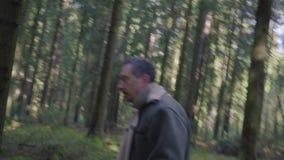 Logger runs away with an ax stock video