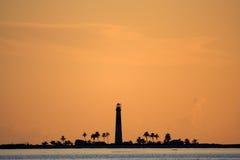 Loggergead Light. A lighthouse silhouette on Loggerhead Key, Dry Tortugas National Park Stock Photo