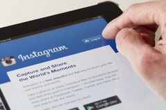 Logging in the Instagram webpage on an ipad Stock Photos
