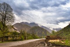 Logging in mountains. Spring stormy clouds. Royalty Free Stock Images