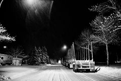 Logging trailers parked on a street Royalty Free Stock Photo