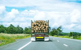 Logging truck driving on State Highway One in Northland, North I. Logging industry truck driving on State Highway One road in Northland, North Island, New Stock Image