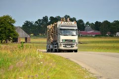 Logging truck on highway Royalty Free Stock Photos