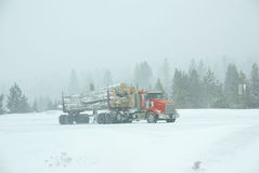 Logging truck on icy road Stock Photo