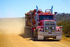 Logging Truck Kicking Up Dust in Tasmania. Logging truck on dirt road in Tasmania, kicking up dust stock images