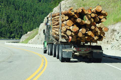 Logging truck on mountain highway Royalty Free Stock Image