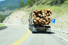 Logging truck on mountain highway Royalty Free Stock Photography