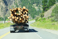 Logging truck on mountain highway Royalty Free Stock Photos
