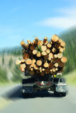 Logging truck on mountain highway Stock Photo
