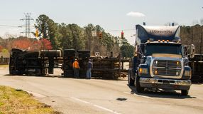 Logging truck turned over on highway stock photo