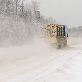 Logging truck on winter road Stock Photography