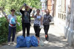 Plogging. young people are happy that they managed to collect city garbage. Saratov, Russia, 10 June 2018. Logging. young people are happy that they managed to royalty free stock photo
