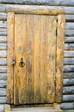Loghouse wooden door with a padlock.  Royalty Free Stock Images