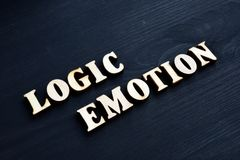 Logic and emotion words from letters. Logic and emotion words from wooden letters stock photos