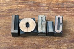 Logic word wood. Logic word  made from scattered wooden letterpress type on grunge wood Stock Image