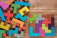 Logical tasks composed of colorful wooden shapes. Visual conundrum. Concept of creative, logical thinking or problem solving. Business concept, rational royalty free stock photos