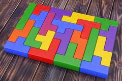 Logical Thinking Concept. Different Colorful Shapes Wooden Block. S on a wooden plank background. 3d Rendering Stock Image